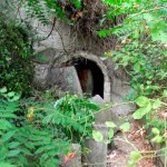the-main-doorway-to-the-nuclear-bunker-located-deep-beneath-the-monument-was-welded-shut-and-impossible-to-pass-however-we-found-a-secondary-entrance-hidden-in-bushes-halfway-up-the-hill