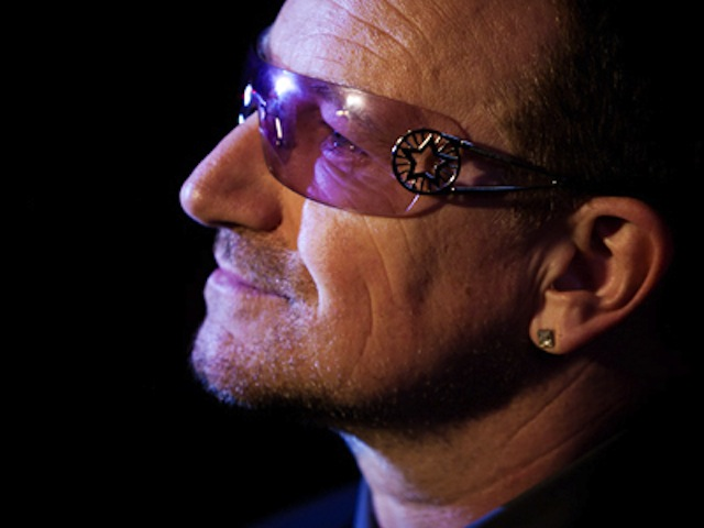 Bono turns Sydney red for World Aids Day
