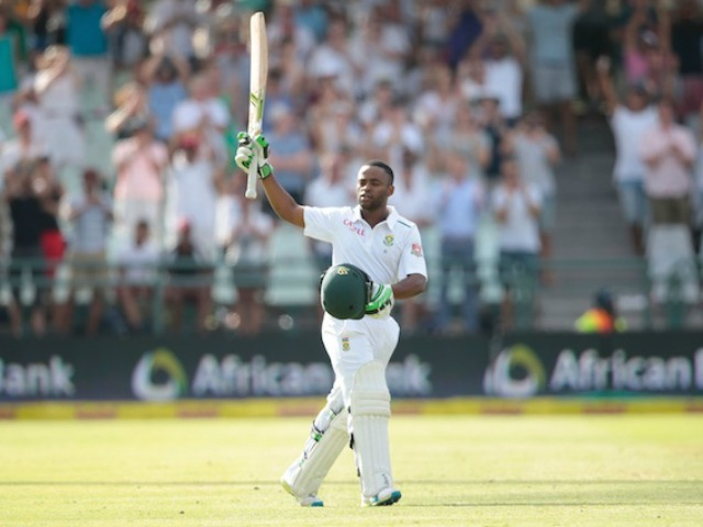 South African batsman Temba Bavuma celebrates after scoring a century (100  runs) during day 4 of the second Test match between England and South Africa at the Newlands stadium on January 5, 2016 in Cape Town, South Africa. / AFP / GIANLUIGI GUERCIA