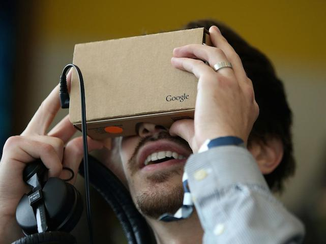 SAN FRANCISCO, CA - MAY 28:  An attendee inspects Google Cardboard during the 2015 Google I/O conference on May 28, 2015 in San Francisco, California. The annual Google I/O conference runs through May 29.  (Photo by Justin Sullivan/Getty Images)