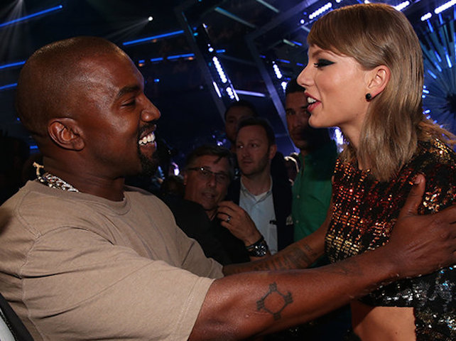 kanye-west-taylor-swift-hug-mtv-vmas-_2015-billboard-650