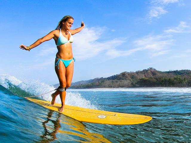 Longboard-girl-Costa-Rica-Surf-Vacations