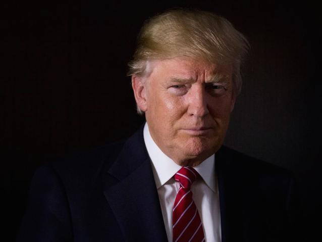 Donald Trump, president and chief executive of Trump Organization Inc. and 2016 Republican presidential candidate, stands for a photograph after a Bloomberg Television interview at his campaign headquarters in Trump Tower in New York, U.S., on Thursday, Oct. 15, 2015. Trump has said he's prepared to spend $100 million or more of his own fortune to win the party's nomination. Photographer: John Taggart/Bloomberg *** Local Capton *** Donald Trump