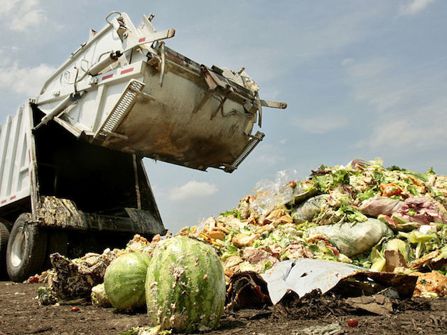 Driver Aaron Cornine lowers the back of the truck after dumping his load of food and compostable waste at Missouri Organic's Liberty facility, July 9, 2009. Much of it is covered in dough from baked goods. (Jill Toyoshiba/Kansas City Star/MCT)