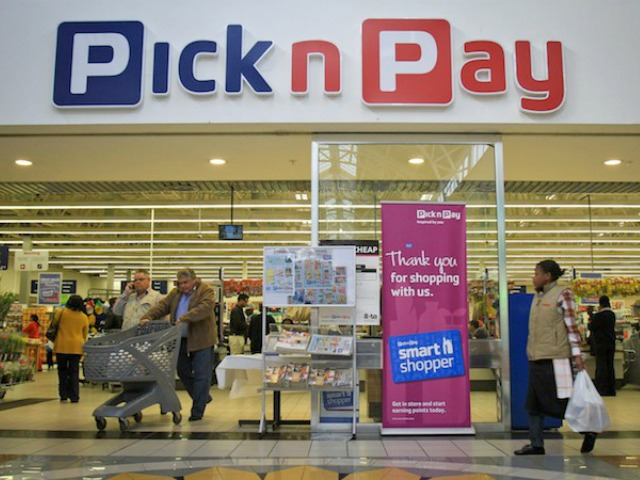 Shoppers leave a Pick n Pay supermarket, in Johannesburg, South Africa, Monday, July 25, 2010. Photographer: Nadine Hutton/Bloomberg News