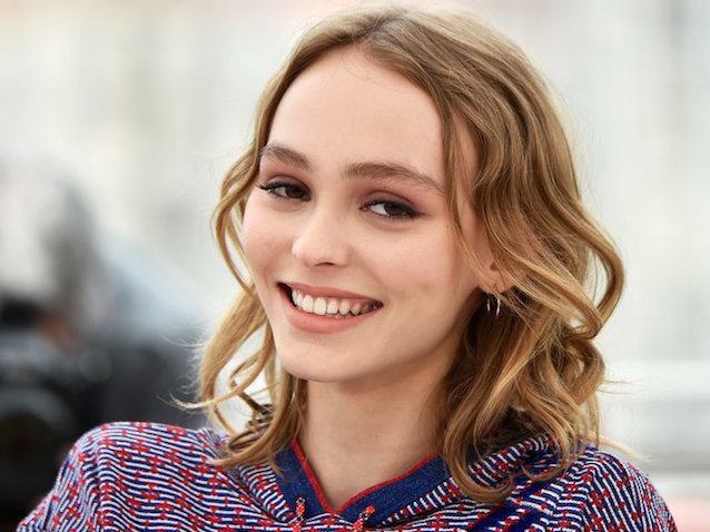"French-US actress Lily-Rose Depp smiles on May 13, 2016 during a photocall for the film ""La Danseuse (The Dancer)"" at the 69th Cannes Film Festival in Cannes, southern France.  / AFP / ALBERTO PIZZOLI        (Photo credit should read ALBERTO PIZZOLI/AFP/Getty Images)"