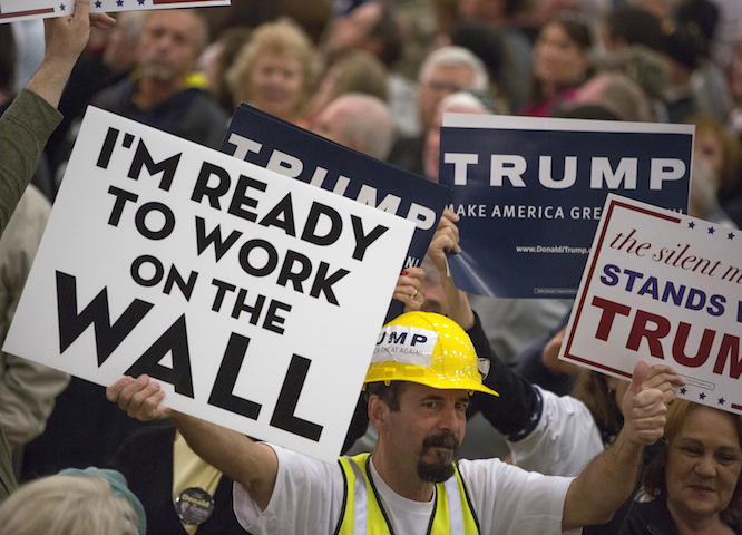 MYRTLE BEACH, SC - FEBRUARY 19: Supporter holds a sign as Republican presidential candidate Donald Trump speaks at a rally February 19, 2016 in Myrtle Beach, South Carolina. Trump is campaigning throughout South Carolina ahead of the state's primary.  (Photo by Aaron P. Bernstein/Getty Images)