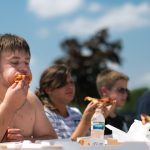 Brett Carlsen | MLive.comKelsey Evans of Burton attempts to keep filling his cheeks with pepperoni pizza in the Flag Festival pizza eating contest.  Evans went on to win the competition by a large margin.7/7/12  Davison, Michigan