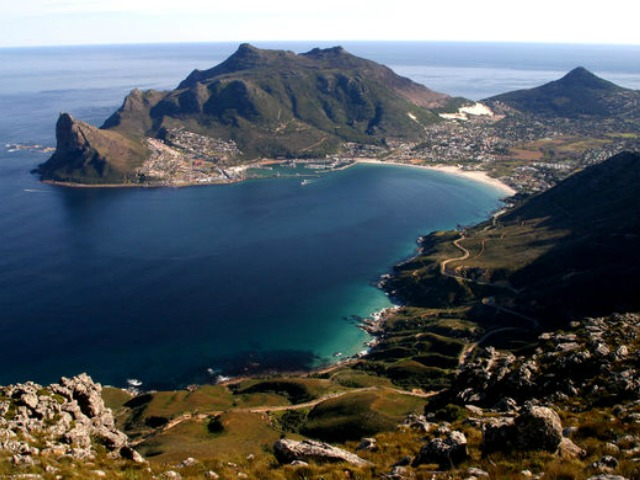 SA Landscapes - Hout Bay, Cape Town, Hout Bay harbour and the Sentinel; viewed from Chapmans Peak, blue sea, Little Lions Head, Cape Town mountains, scenic view of Cape Town.© Jeremy Jowell