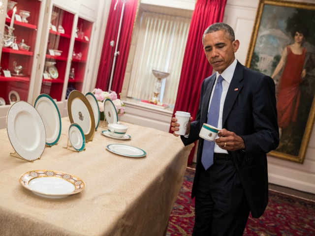 President Barack Obama previews the new Obama White House China pattern on display in the China Room of the White House, April 23, 2015. (Official White House Photo by Pete Souza)