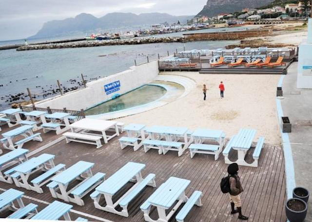 Cape Town - 140608 - A group of community members protested outside the Brass Bell in Kalk Bay this morning. They say the Brass Bell has built decks on the beach and has blocked access for the community to the beaches and tidal pools. Reporter: Anne Steele Picture: David Ritchie (083 652 4951)