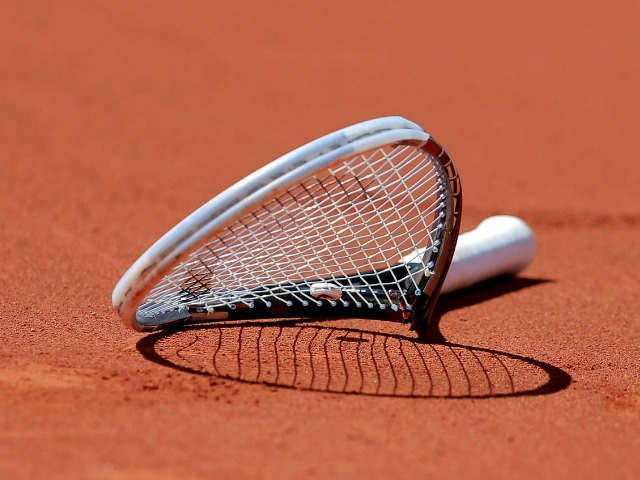 The broken racket of Novak Djokovic of Serbia is seen on the court after he smashed it during his men's semi-final match against Ernests Gulbis of Latvia at the French Open tennis tournament at the Roland Garros stadium in Paris June 6, 2014.              REUTERS/Vincent Kessler (FRANCE  - Tags: SPORT TENNIS TPX IMAGES OF THE DAY)   ORG XMIT: SAA67